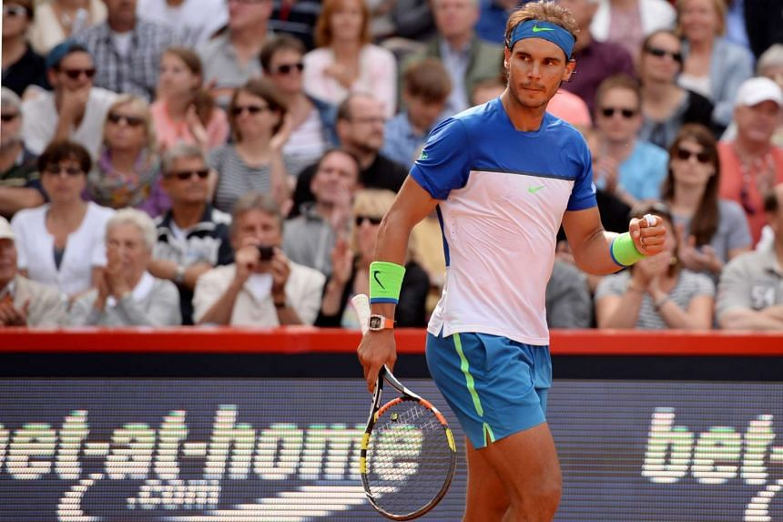 Spain's Rafael Nadal celebrates winning his semifinal match.