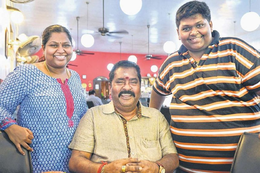 Fishhead curry from Samy's Curry Restaurant, run by Mr V. Maheyndran (above centre) and his children, Ms Nagajyothi Mahendran and Mr M. Veerasamy.