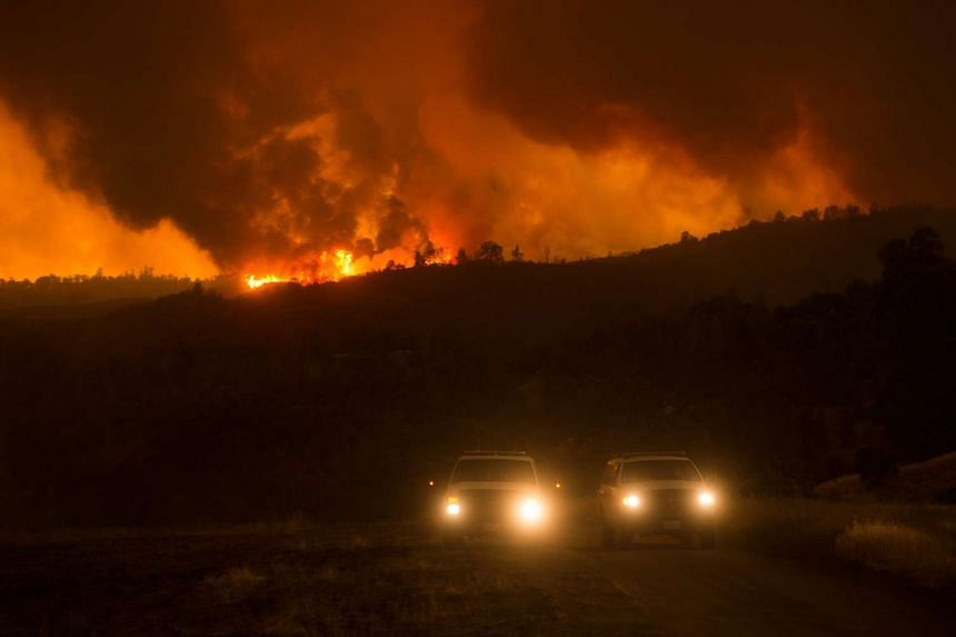 Flames crest a hilltop as the Rocky fire burns near Clearlake, California, USA on August 1, 2015.