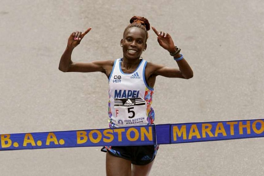 Rita Jeptoo of Kenya crosses the finish line to win the women's division of the 110th Boston Marathon in an unofficial time of 2:23:38 in Boston, Massachusetts on April 17, 2006.
