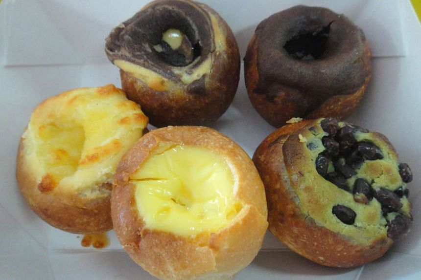 Mr Baguette offers mini bread bowls with fillings of (clockwise from left) cheese, hazelnut, chocolate, green tea with azuki beans and egg pudding.