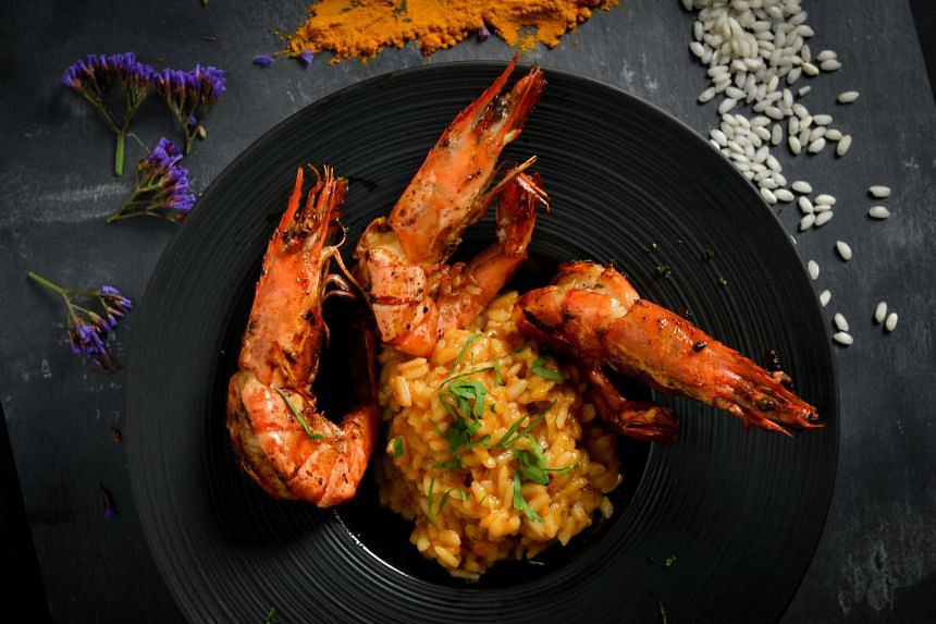 Tuck into main dishes such as Spicy Prawn Risotto.
