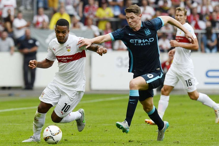 Stuttgart's midfielder Daniel Didavi (left) and Manchester's midfielder George Evans vie for the ball.