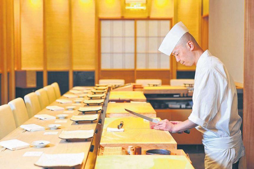 Chef Koichiro Oshino (above) at Shinji.