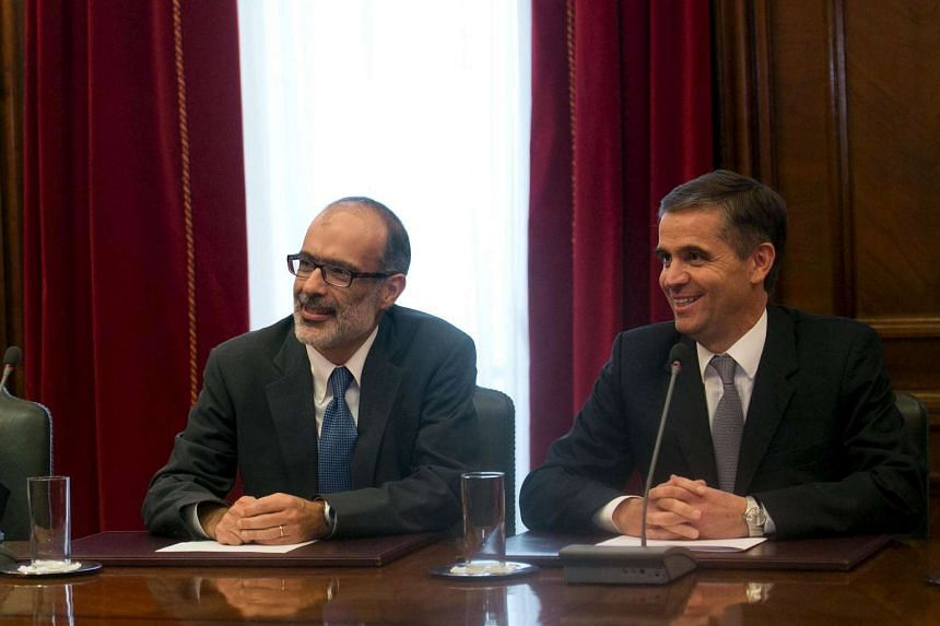 Chile's new finance minister Rodrigo Valdes (left) and Central Bank President Rodrigo Vergara attend a Monetary Policy Meeting at the Central bank building in Santiago, May 14, 2015.