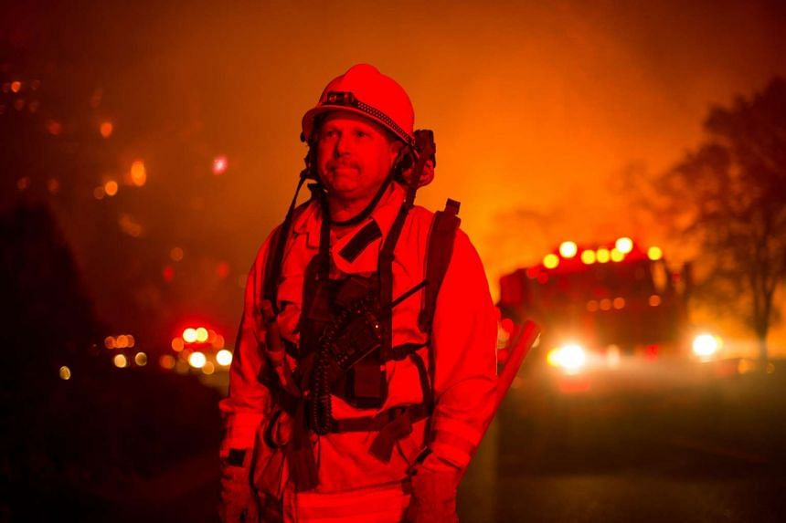 Firefighter Scott Bauder watches for flying embers while battling the Rocky fire near Clearlake, California, on Aug 2, 2015.