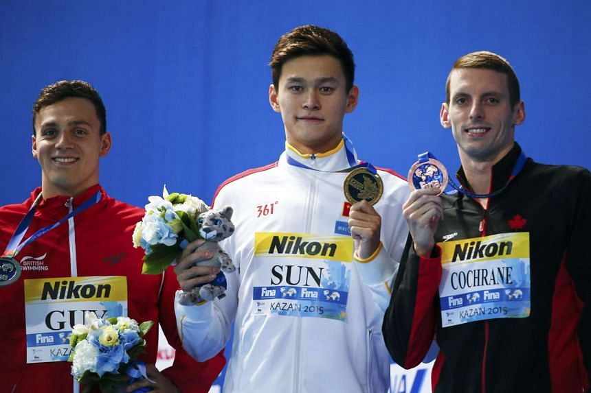 Second placed James Guy of Britain, first placed Sun Yang of China and third placed Ryan Cochrane of the United States posed with medals after the 400m men's freestyle final at the Aquatics World Championships in Kazan, Russia on Aug 2.
