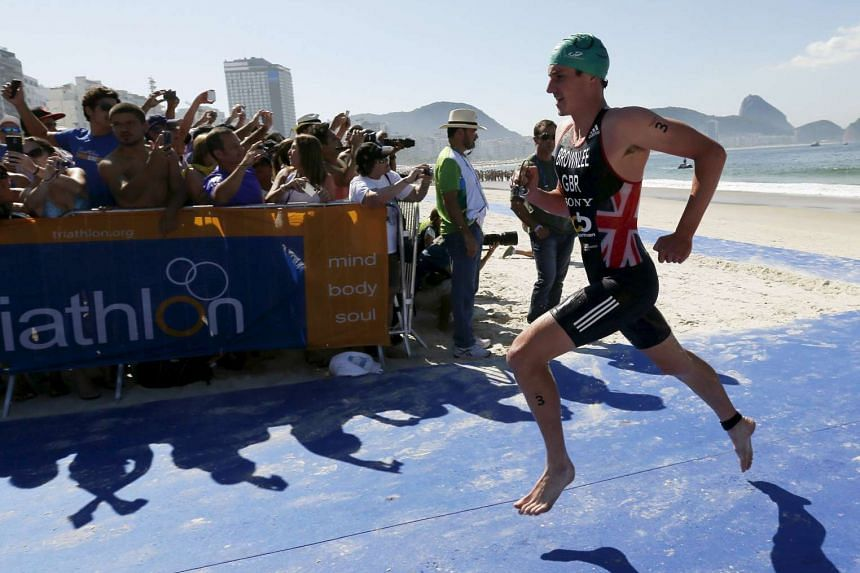 Mr Alistair Brownlee of Britain starts running after the swimming leg of the men's triathlon at the ITU World Olympic Qualification event on Copacabana beach in Rio de Janeiro on Aug 2.