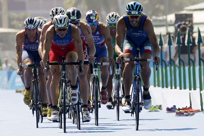 Mr Javier Gomez Noya of Spain leads a pack of riders during the bike portion in the men's triathlon at the ITU World Olympic Qualification event on Copacabana beach in Rio de Janeiro.