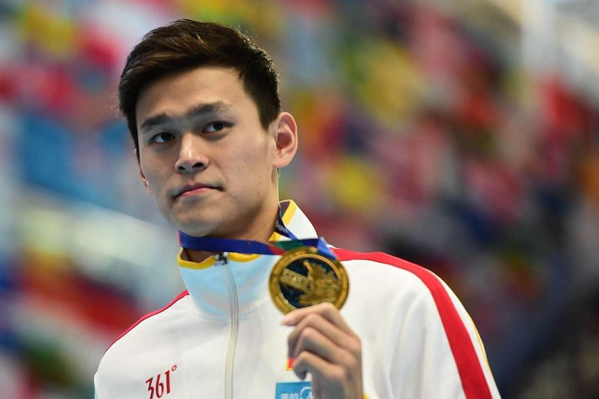 Gold medalist China's Sun Yang poses during the podium ceremony of the men's 400m freestyle swimming event at the 2015 FINA World Championships in Kazan on Aug 2.