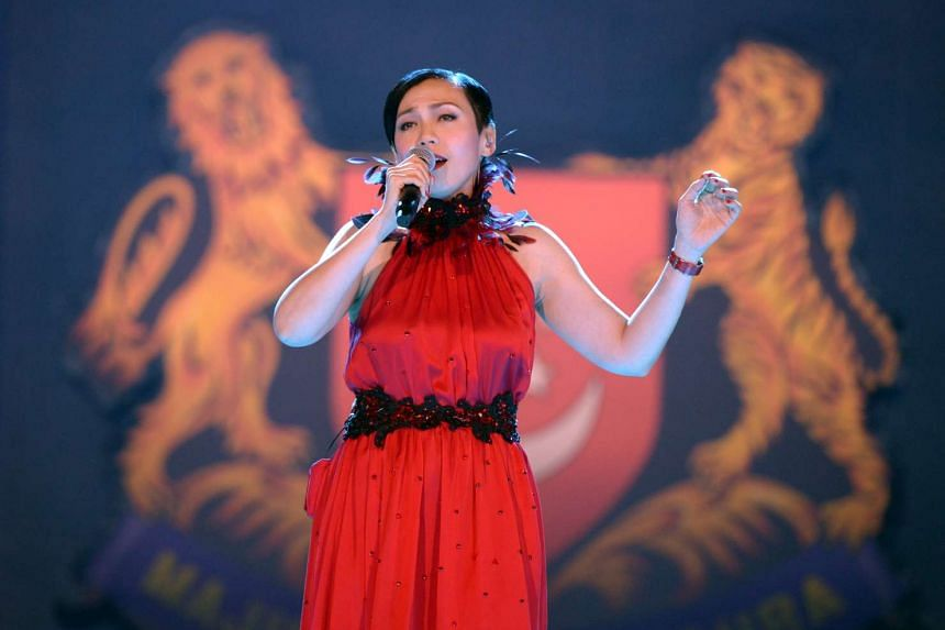 """Kit Chan singing """"Home"""" at the National Day Parade 2015 Preview on Saturday."""