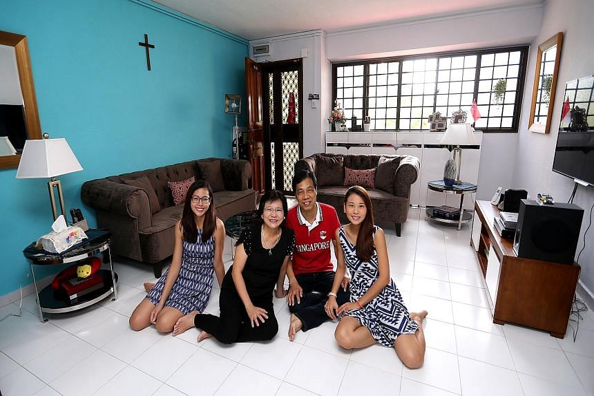 Mr Richard Chua with his wife Adeline and their daughters Radiant (far left) and Lydia in their living room after the makeover.