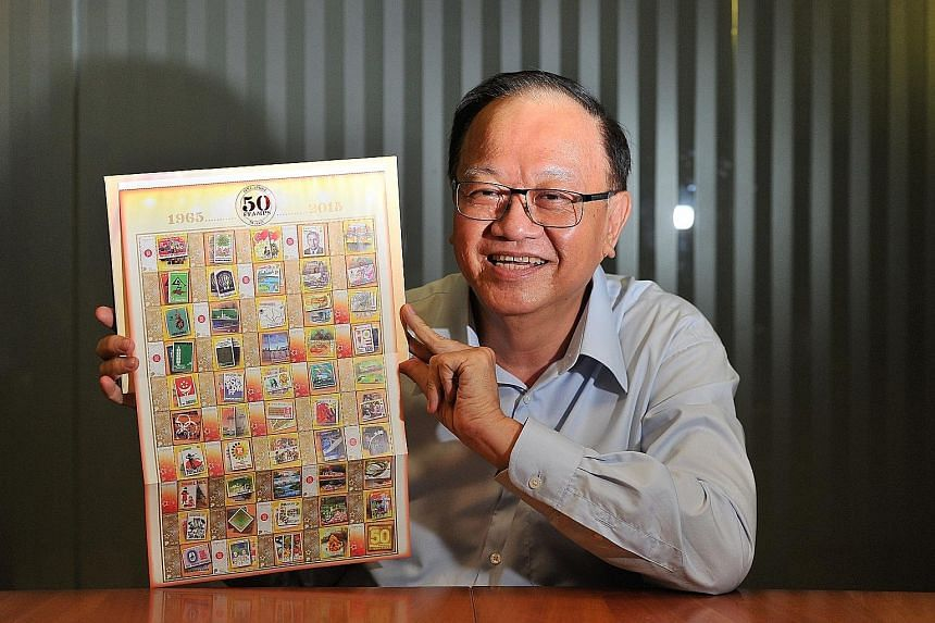 Mr Woo Keng Leong with SingPost's SG50 set of 50 stamps depicting designs from the past five decades.