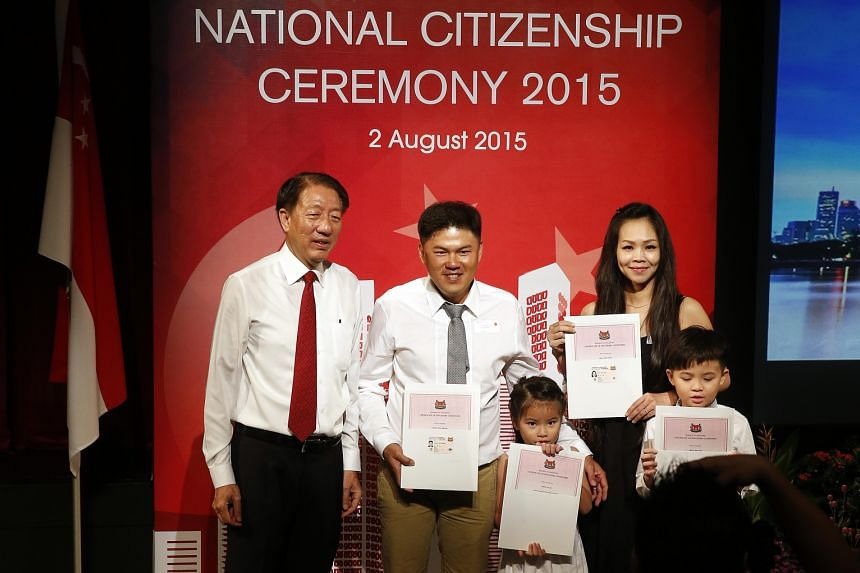 (From left) DPM Teo with new citizens and Pasir Ris-Punggol residents Chong Kuin Sheong, 37; Ke Qi, Mr Chong's six-year-old daughter; wife Chai Yoon Fong, 37; and son Hao Yan, eight.