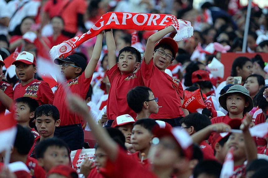 Schoolchildren attending a National Day Parade rehearsal on July 25. PM Lee Hsien Loong noted that the next generation of Singaporeans will be born into a world where the people they identify with need not be geographically close.