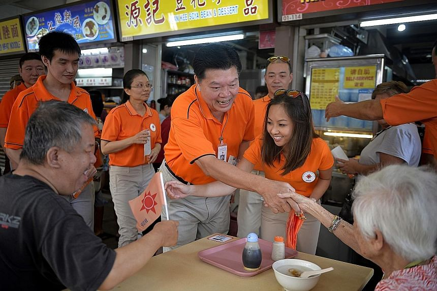 Ms Nicole Seah (above) at her home in 2011. Many constituents were won over by her eloquence and charisma.National Solidarity Party president Sebastian Teo (right, centre) and party member Kevryn Lim greeting MacPherson residents at the Circuit Road