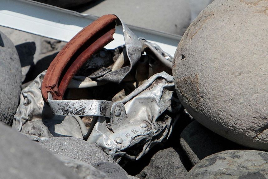 A mangled piece of metal with Chinese characters inscribed on it has been found on La Reunion island. Yesterday, several pieces of debris, one of which was believed by locals to be from a plane door, sparked excitement. However, investigators quickly