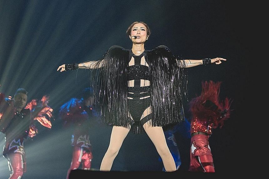Sammi Cheng sang and danced in costumes that incorporate peekaboo leotards.