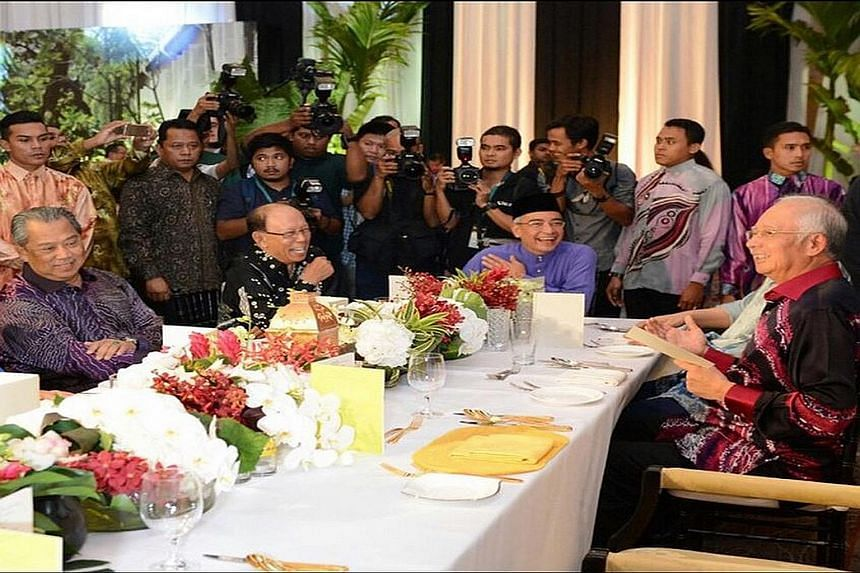 Mr Muhyiddin Yassin (left) and Mr Najib Razak (right) with other guests at a Hari Raya open house hosted by Mr Najib's brother - Nazir (in purple) - last Monday, a day before the PM sacked Mr Muhyiddin.