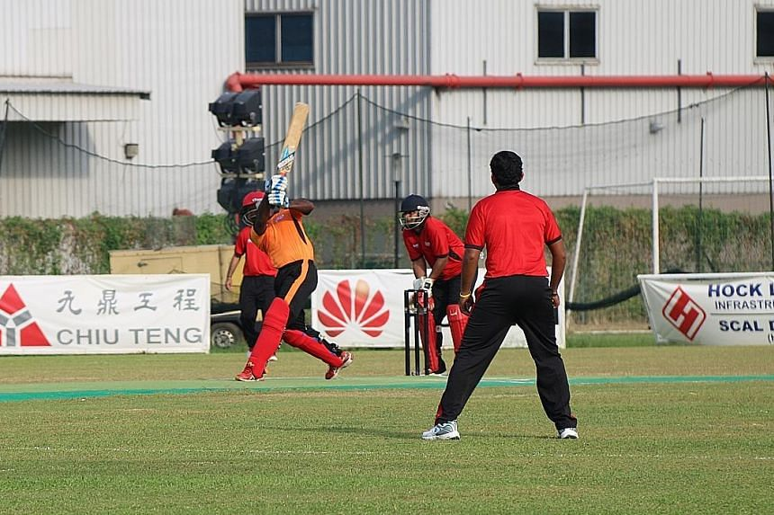 Chaminda Ruwan of Construction All-rounders hitting a six in the final to help his team lift the inaugural CricHQ Red Dot Trophy. They beat Technology Torpedoes by 31 runs at the Yorker Ground yesterday.