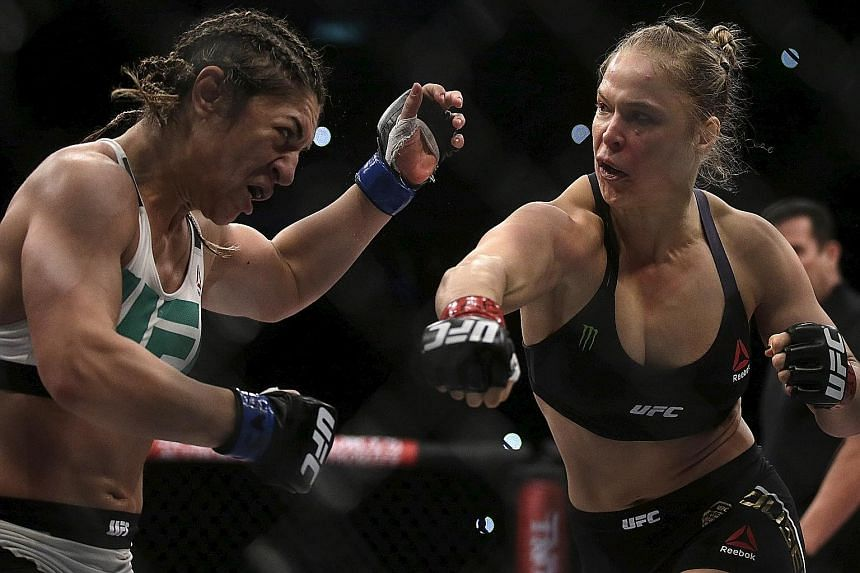 American Ronda Rousey (right) finishing off Bethe Correia in just over half a minute in their UFC bantamweight match in Rio de Janeiro on Saturday. The trash-talking Brazilian had little support from her home crowd as they seemed to know she stood li