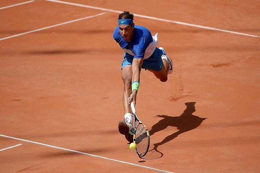 Rafael Nadal stretching to return a mid-court shot against Fabio Fognini. His 67th clay-court title comes after a lean spell this season, both on his favourite clay and in grand slam events.