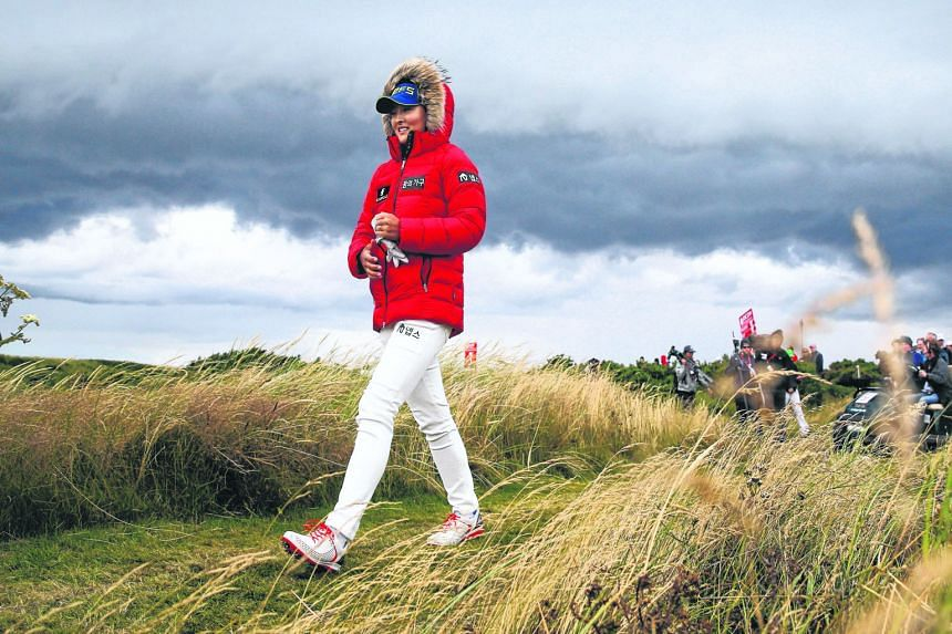 South Korean Ko Jin Young, in thick clothing against the cold in Scotland, walking from the third tee in the third round. The Major debutante has outshone the better-known Ko - Lydia.