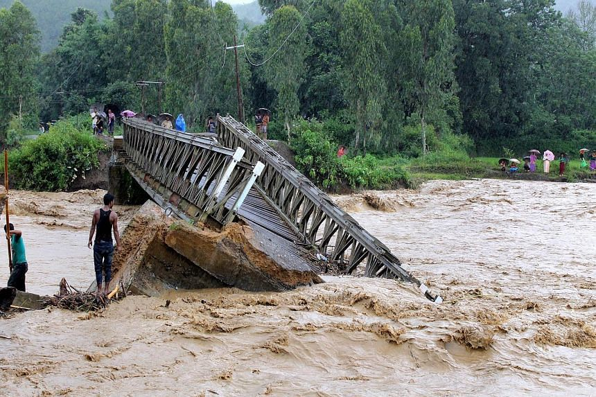 A bridge wrecked by raging floodwaters in Thoubal district in Manipur state yesterday.