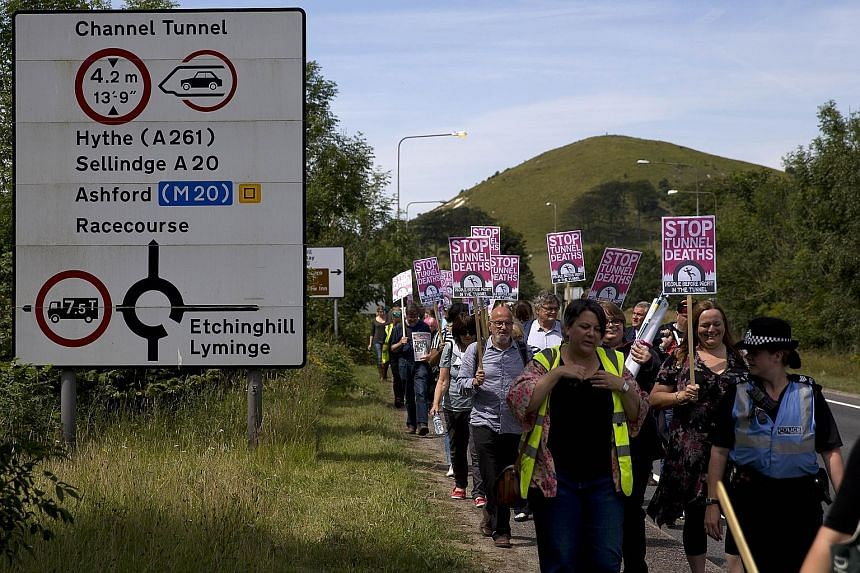 Pro-migrant protesters near the Eurotunnel terminal in Folkestone on Saturday. The town was also the scene of rival protests by anti-migrant groups.