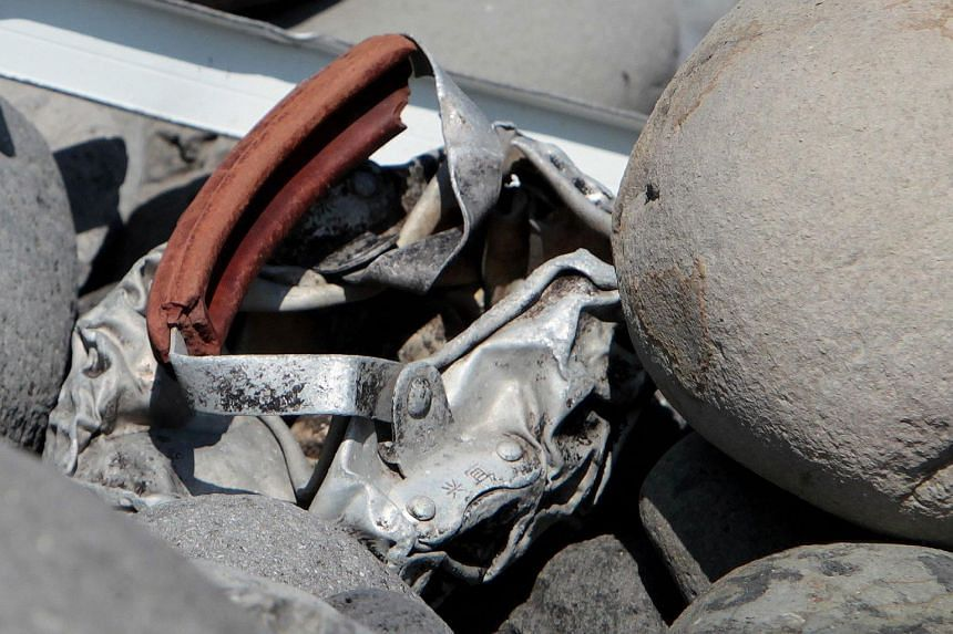 Metallic debris found on a beach in Saint-Denis on the French Reunion Island in the Indian Ocean on Aug 2, 2015, close to where where a Boeing 777 wing part believed to belong to missing flight MH370 washed up last week.