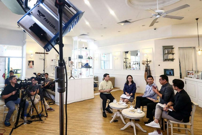 (From left) Mr Lee Yi Shyan, Lianhe Zaobao reporter Chen Jing,  Mr Samuel Ng, Mr Chua Chim Kang and Mr Wong Woon Hong filming an espisode of the talk show.
