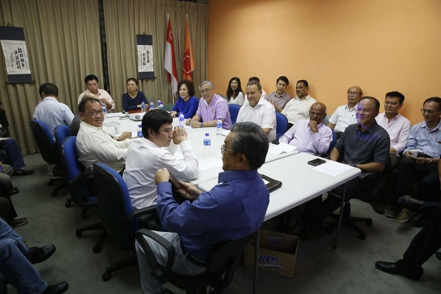 Representatives from the various opposition parties gather for a meeting at National Solidarity Party's headquarters on Aug 3, 2015.