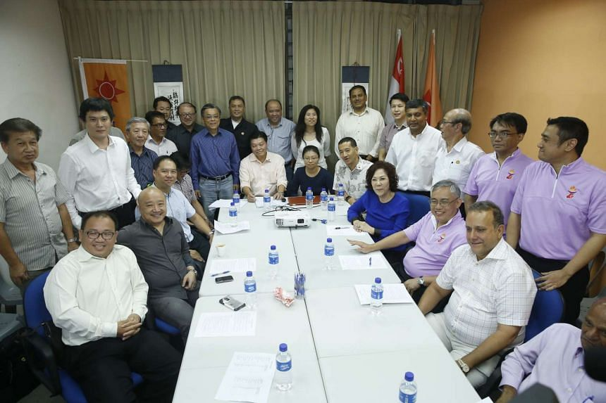 Representatives from the various opposition parties pose for a group photo before they commence a meeting at National Solidarity Party's headquarters on Aug 3, 2015.
