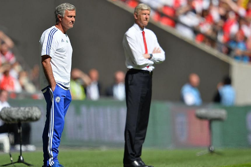 Jose Mourinho (left) and Arsene Wenger watch from the side during the FA Community Shield football match between Arsenal and Chelsea at Wembley Stadium on August 2, 2015.