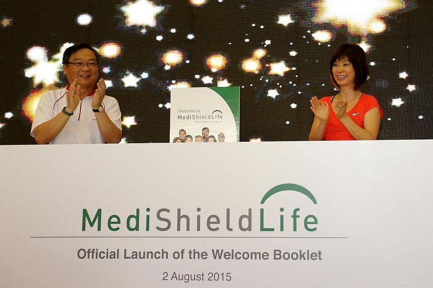 Gan Kim Yong (left) and Amy Khor attend the distribution of the MediShield Life booklet at ITE Choa Chu Kang.