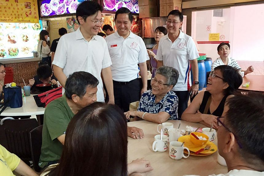 Minister for Culture, Community and Youth Lawrence Wong mingled with Yew Tee residents at a foodcourt in Limbang Shopping Centre.