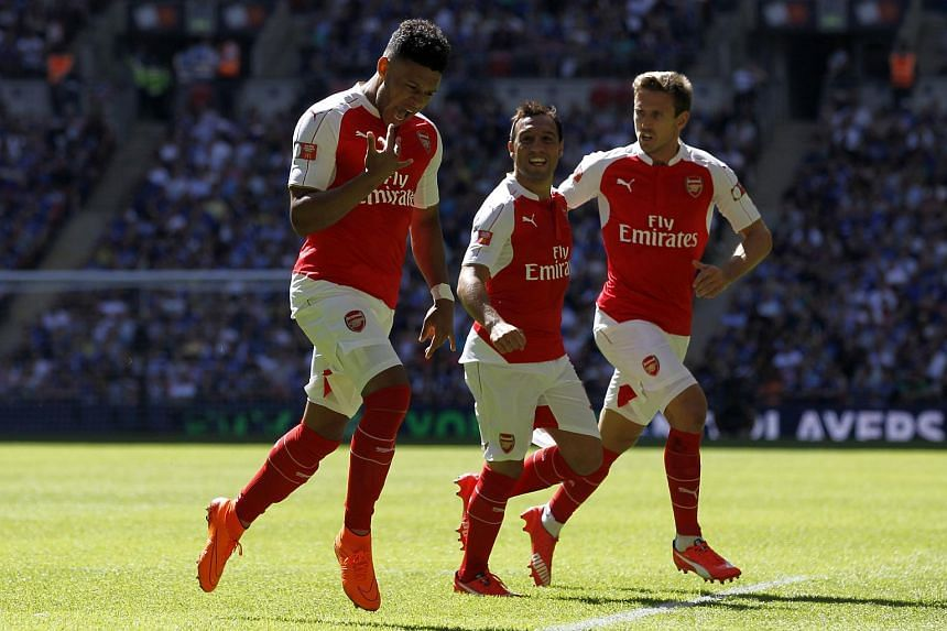 Arsenal's English midfielder Alex Oxlade-Chamberlain (left) celebrates scoring the opening goal of the FA Community Shield football match between Arsenal and Chelsea.