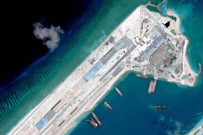 This file handout photograph shows a satellite image of what is claimed to be an under-construction airstrip at Fiery Cross Reef in the Spratly Islands in the disputed South China Sea.