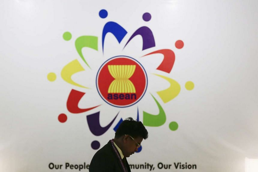 A man walks past an ASEAN billboard inside of the Putra World Trade Centre, the venue of 48th ASEAN Foreign Ministers' Meeting (AMM) / Post Ministerial Conference (PMC) at Kuala Lumpur, Malaysia.