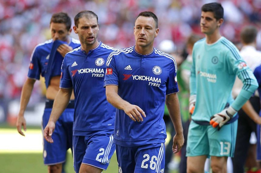 Chelsea's John Terry (right) and Branislav Ivanovic walking off the field after their team's 1-0 loss to Arsenal during their FA Community Shield match at Wembley Stadium on Aug 2, 2015.
