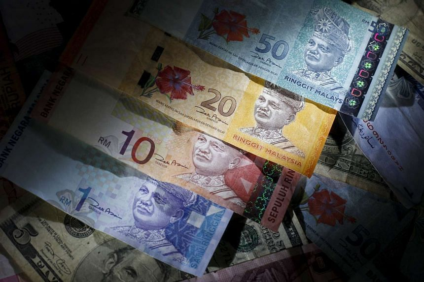 The value of the Malaysian ringgit fell by the most in four weeks on the back of a contraction in Malaysia's factory output.