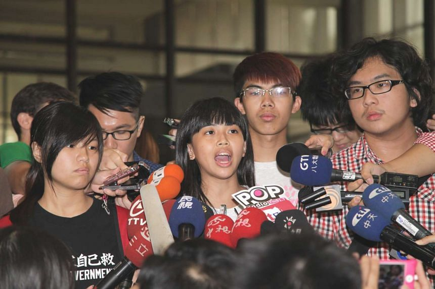 Taiwanese student leader Wang Pin-chen (centre) speaks to reporters before their meeting with Taiwan's Education Minister Wu Se-hwa (not pictured), demanding him to scrap 'China-centric' school curriculum's guidelines and his resignations, in Taipei,