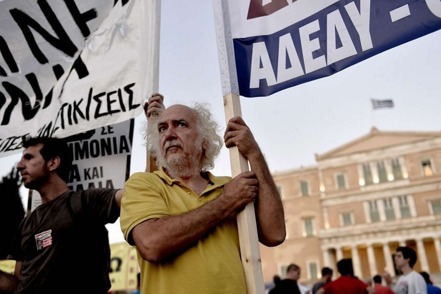 A file picture of protesters demonstrating outside the Greek parliament in Athens on July 22, 2015. PHOTO: AFP