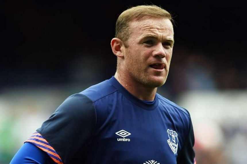 Wayne Rooney warms up ahead of the Duncan Ferguson Testimonal pre-season friendly football match between Everton and Villarreal at Goodison Park in Liverpool on August 2, 2015.