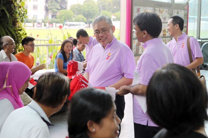 Goh Meng Seng (centre) and Syafarin Sarif (on his right) of People's Power Party outside Lot 1 on a walkabout on Aug 2, 2015.