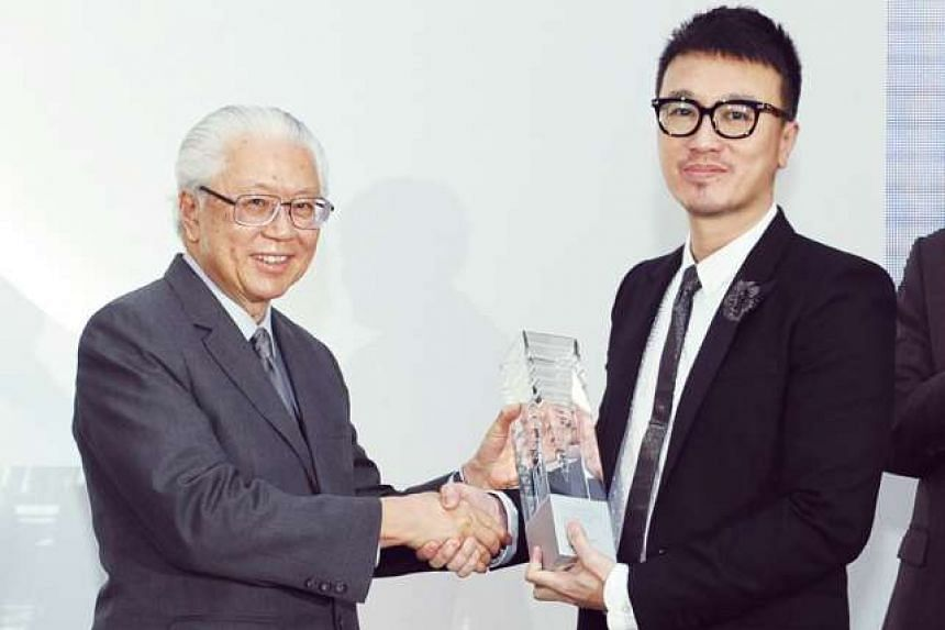 My life so far: Peh with some of The Design Society founding members Jackson Tan, Chris Lee, Hanson Hoand Pann Lim in 2012 and (above) receiving the President's Design Award from President Tony Tan last year.