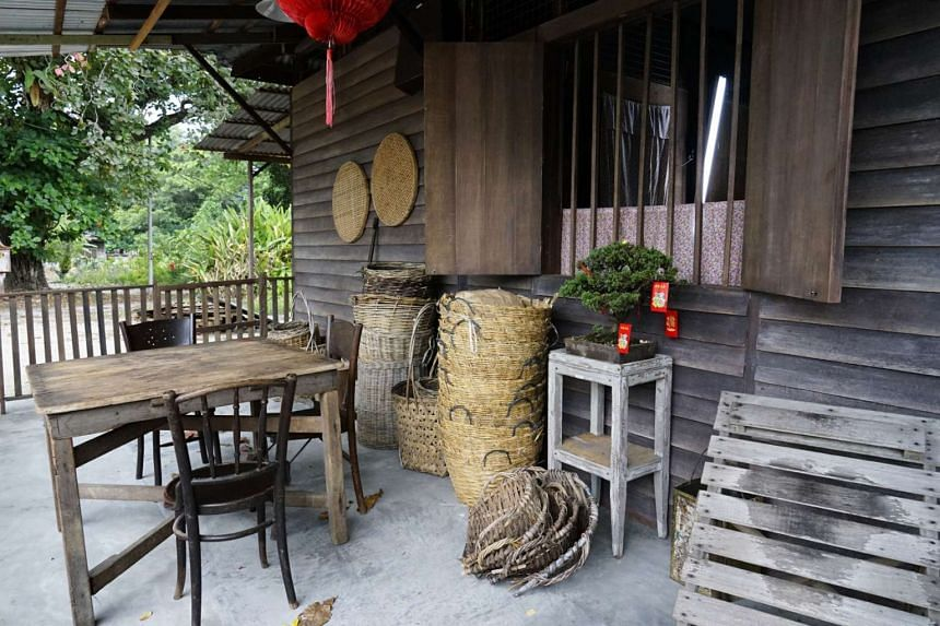 The sewing area and patio (above) of the one-storey Ipoh home, rented from a carpenter, where director Jack Neo is shooting scenes for Long Long Time Ago.