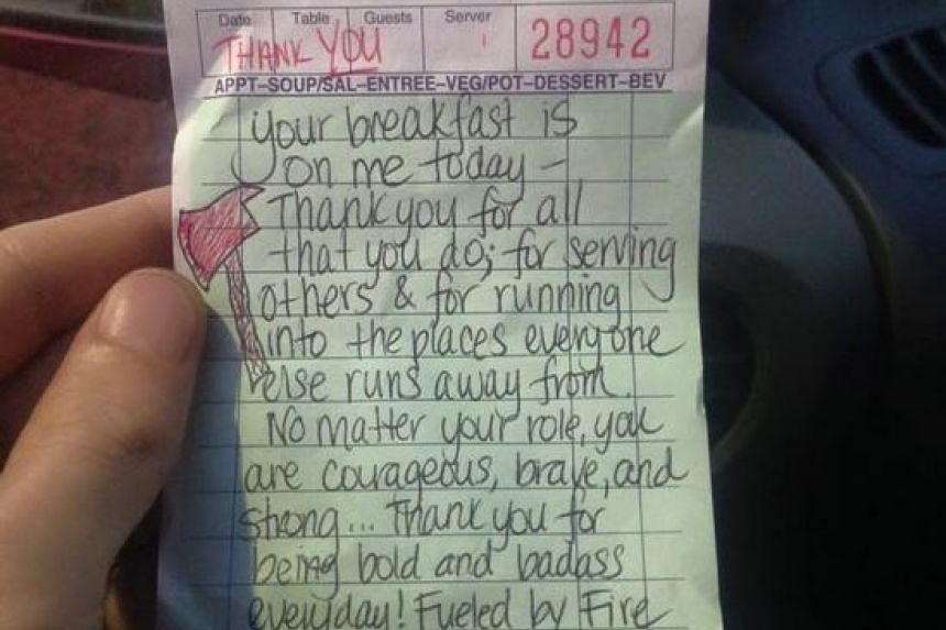 The thank you note written by waitress Liz Woodward to the two firefighters.
