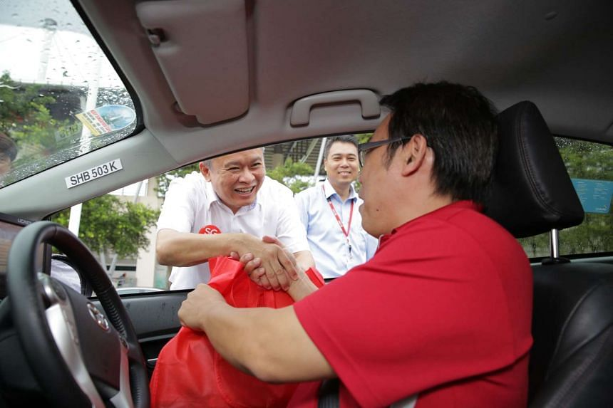 Mr Yeo Eng Tong, 51, receives his SG50 Goodie Bag from Mr Ang Hin Kee.