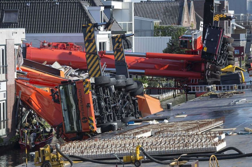 Two cranes fell onto houses in Alphen aan den Rijn in Netherlands, on Aug 3, injuring about 20 people.